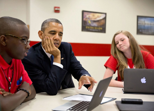 President Obama and students with laptops