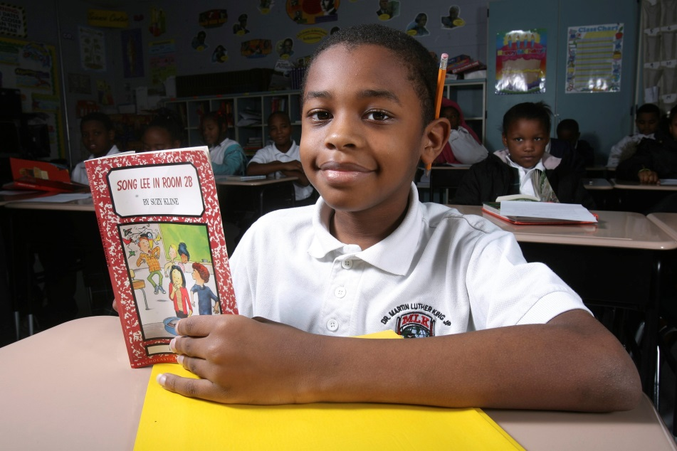Student in the classroom reading a book
