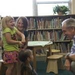 Senator Harkin with a student and teacher at Carver Community School in Des Moines.