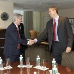 Secretary Duncan greets Minister Plasterk