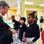 Minneapolis Mayor R.T. Rybak is greeted by Elizabeth Hall International Elementary School 5th graders as he arrives for the Promise Neighborhoods grant announcement. Photo by Bre McGee for the U.S. Department of Education.